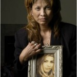 Sylvia Araujo hold a picture of her daughter Gwen.